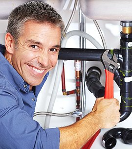 Expert plumber with tools